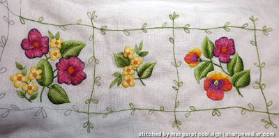 Three completed elements from a Duftin table runner. House of Embroidery variegated threads were added.