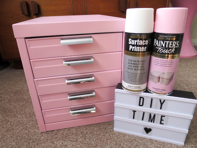 Usingt Rust-olum priner and candy pink paint, this filing cabinet was easily changed over the weekend.