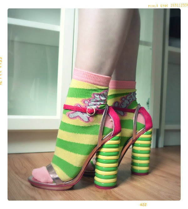 one foot in front of the other of Twister ice lolly heeled sandals with socks