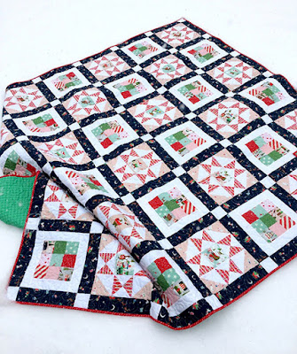 Glad Tidings Quilt Free Pattern designed by Suzanne of Splendid Speck