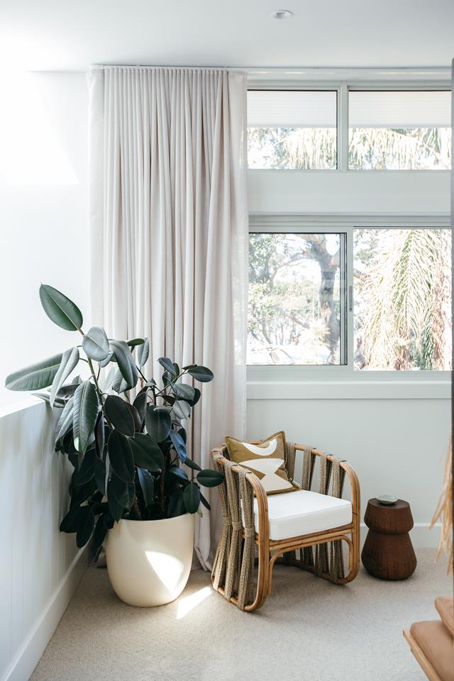 Corner armchair and plant in the main bedroom