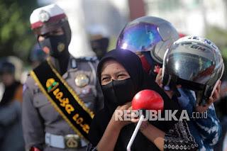 Polres Lombok Utara Bagikan 1.300 Masker kepada Masyarakat