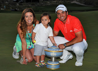 Jason, his wife Ellie, and son Dash showcasing his trophy