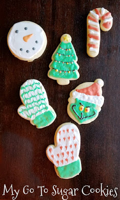 sugar cookies decorated with royal icing for christmas time