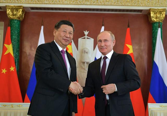ڕوسیا و چین هاوبەشی دەکەن بۆ کەمکردنەوەی پشت بەستن بە دۆلار