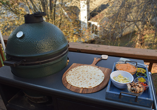 Mise en place on the Big Green Egg in a Challenger Designs Torch grill cart.