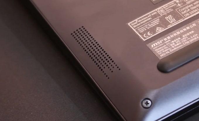 The down-firing speaker of MSI Modern 14 B4MW laptop.
