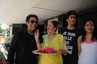 Govinda celeting Holi with His family wife daughter 016.JPG