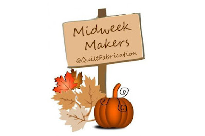 midweek makers on a sign with pumpkins