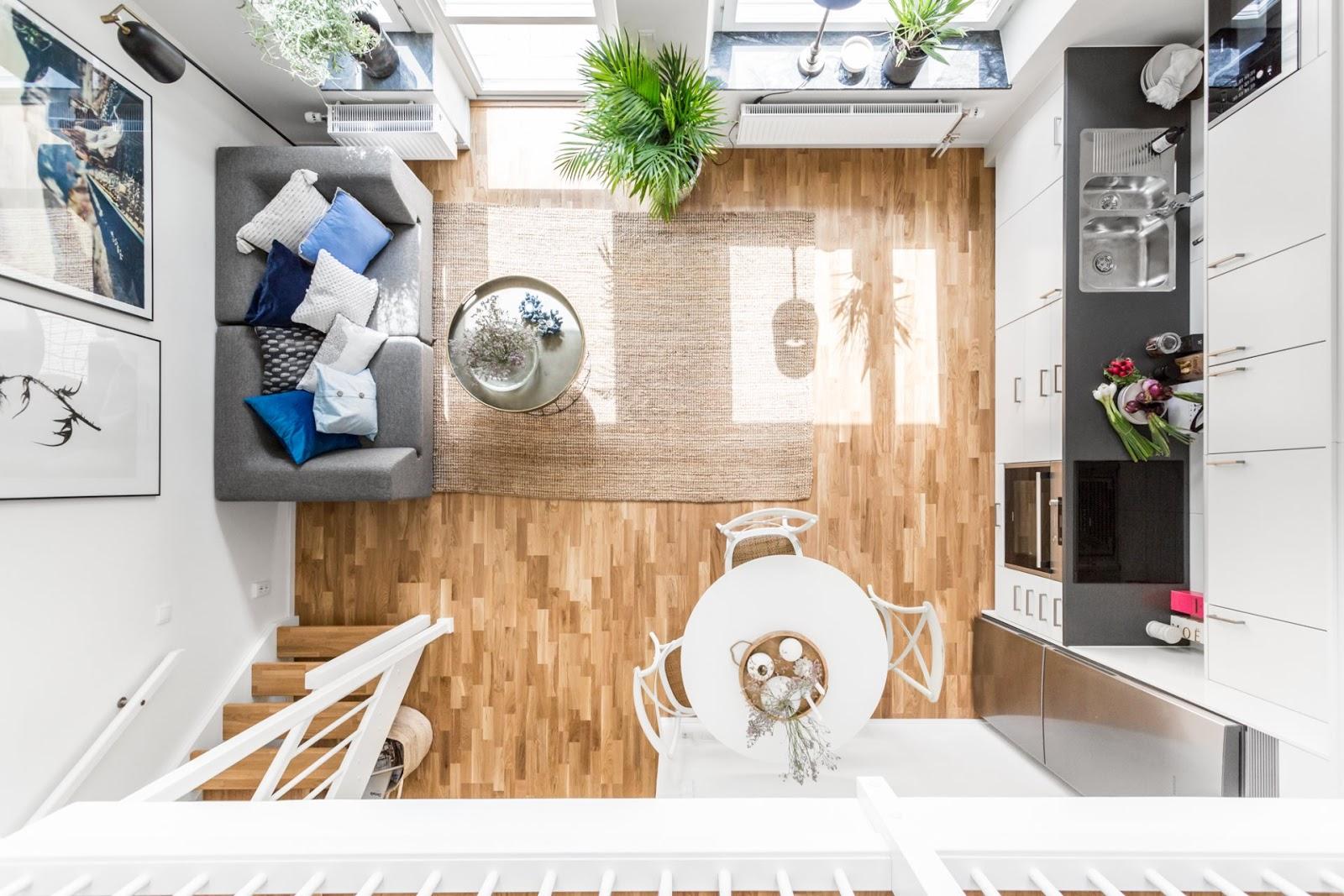 Proiect de amenajare în stil scandinav pentru un apartament de 49 m² cu dormitor la mezanin