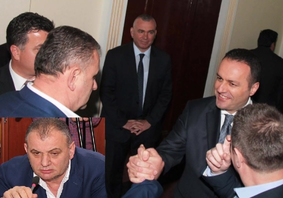 Aqif Rakimi shaking hands with former general prosecutor Adriatik Llalla