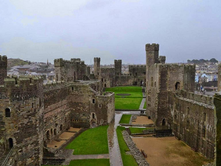 Caernarfon Castle in Wales was created by King Edward I. I couldn't wait to visit, and it didn't disappoint. - This Guy Sold Everything He Owned To Bike Through 70 Countries In 5 Years