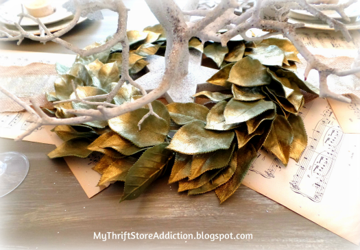 All That Glitters: Rustic Glam Birch Slices and Tablescape mythriftstoreaddiction.blogspot.com Thrift store wreath came painted gold--no makeover required, placed at the base of rustic tree centerpiece