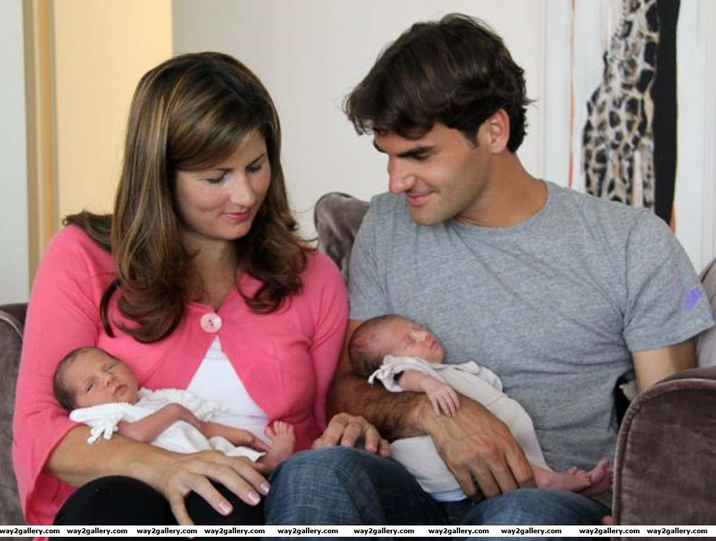Tennis star Roger Federer and his wife Mirka Vavrinec hold their twin daughters Charlene Riva and Myla Rose The twins were born July