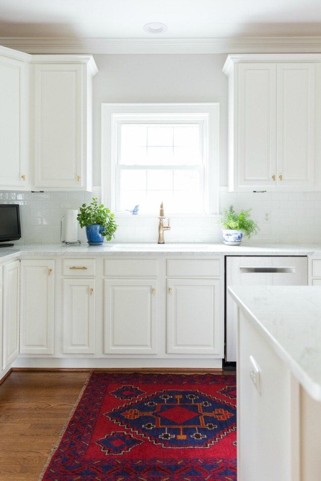 white and gold kitchen, kitchen makeover, white cabinets, persian rug