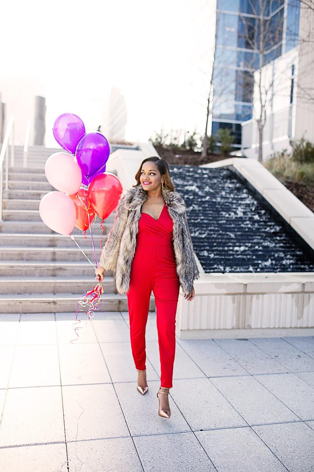 asos red jumpsuit- valentines day outfit ideas- zara metallic heels- asos faux fur jacket- how to wear jumpsuit- fashion blogger- black girl blogger- dallas blogger- fashion balloon photoshoot-red lips woman of color- blush pink jumpsuit
