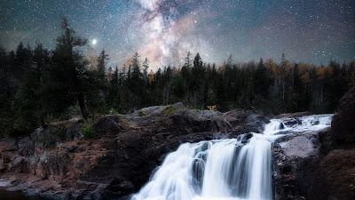 Landscape wallpaper of beautiful waterfall at night