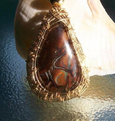 https://www.etsy.com/listing/274346282/14k-gf-boulder-opal-pendant?ref=shop_home_active_1