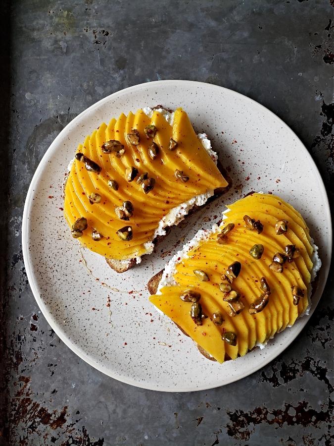 MRicotta Toasts With Mango & Honeyed Pistachios