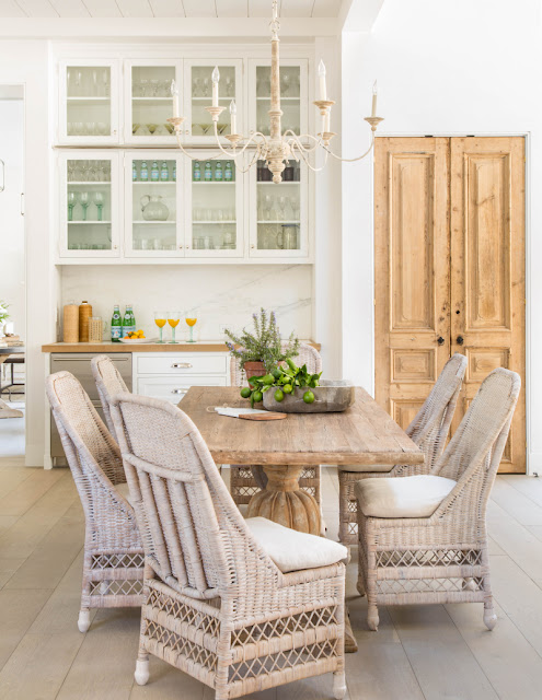 Modern farmhouse dining area in kitchen with vintage finds by Giannetti