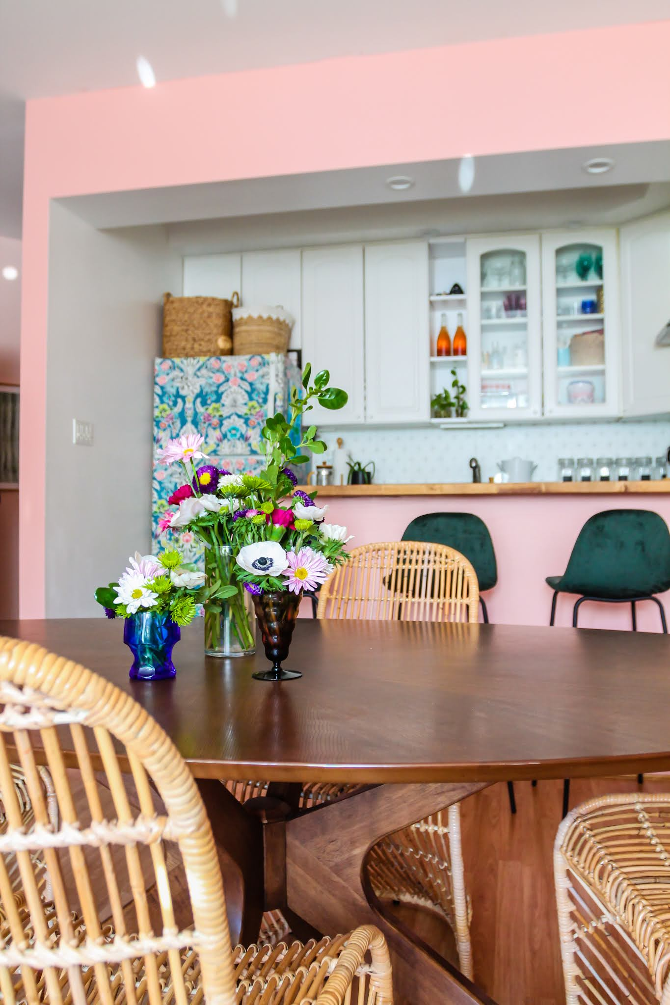 pink and green decor // green barstools // pink kitchen // diy wallpaper fridge // pink and green kitchen // colorful homes // Megan Zietz  Apartment // TfDiaries // pink and green room // pink and green Inspo // barstool inspo // velvet barstools // in mod Sigfred barstool // Green Velvet Mid Century Barstools // pink kitchen // pink room // boho decor