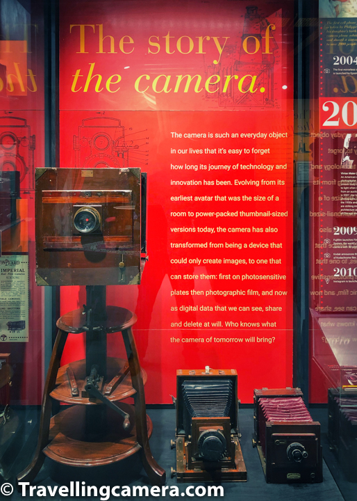 """A visit to Museo Camera, a museum dedicated to the history of cameras and photography, was long pending. Ever since it opened in the beginning of this year, VJ and I had talked often about it. Museo Camera, India's first not-for-profit, crowd-funded Center for Photographic Art, is an inspiring story in itself. Aditya Arya's years of hard work, dedication, and passion to the field of photography have culminated in the creation of this magical space.   The museum, earlier located in the basement of Aditya Arya's home, has now shifted to this beautiful building that is a fine specimen of strong, industrial architecture. Built around a mesh of sturdy, exposed iron beams, the museum is a sight to behold. And we have not even started talking about the content yet.   Located in one of the prime addresses of Gurgaon, DLF Phase 4, Museo Camera houses over 1500 cameras and 100s of other photography equipment such as apertures, light meters, artificial lighting equipment from various eras and was created through citizen funding. One of the most remarkable galleries in the museum is the one that covers the history of photography spanning across more than 200 years and a history of cameras.   The gallery starts with a prototype of Camera Obscura. The word Camera Obscura is latin and literally means the dark room. Mr Arya told us the that the word Camera was earlier spelled with a """"K"""". So it was """"Kamera"""". The urdu word """"kamra"""" probably has the same origin. Languages are really interesting, aren't they?   Anyhow, the original Camera Obscura used to be as large as a room. The one in the Museum is a small box just to demonstrate how the original equipment used to work. Basically the basis is a natural optical phenomenon known as the pinhole image. When a scene outside a tent or a wall is projected on the otherside through a small opening, it appears reversed. This kind of a projection was earlier used for creating sketches and to study solar eclipse without damaging the eyes.   Then"""
