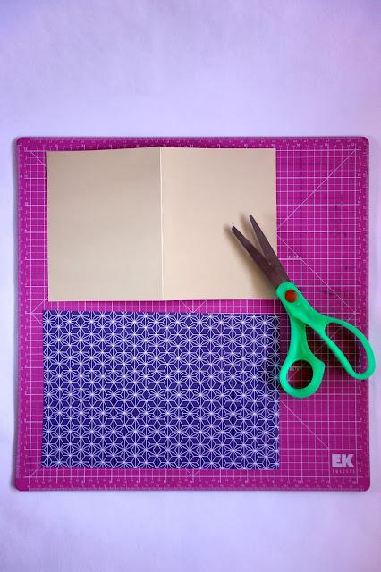 self-healing mat, scissors, card stock, scrapbook paper, craft materials