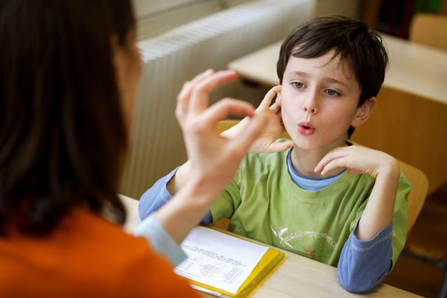 speech and language therapist working with child
