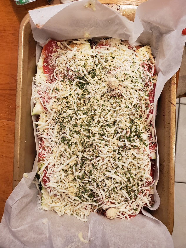 this is a pan of zucchini lasagna ready to be baked in the oven