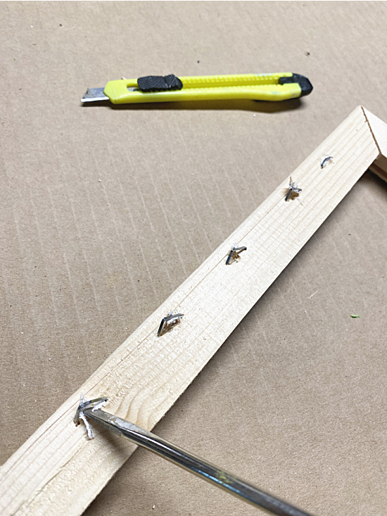 loosen staples with a screwdriver