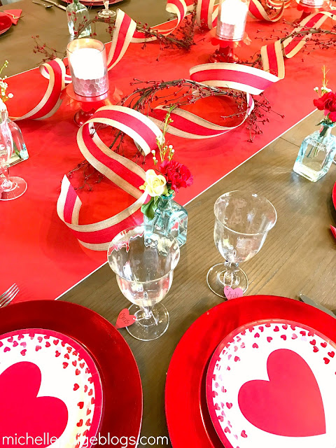 Paper runner, curled ribbon, paper plates to decorate for Valentine's Day