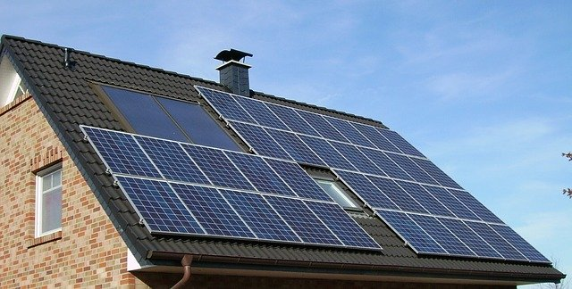 Numerous solar panels on the roof of a family house