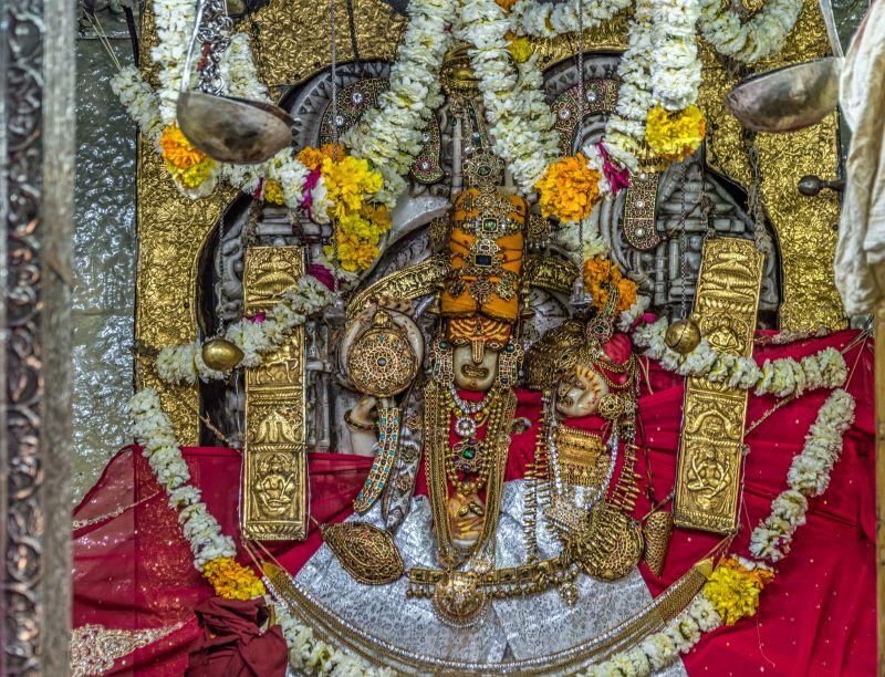 idols of Lord Vishnu and Goddess Lakshmi inside sanctum sanctorum of  Laxmi Nath Ji Temple