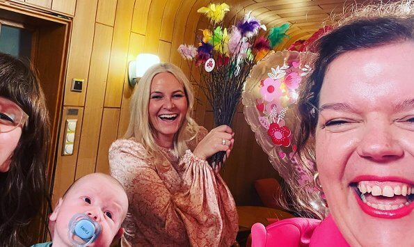 Else Kass Furuseth shared a photo of her and Crown Princess Mette-Marit. Mette-Marit wore a balloon sleeve floral print midi dress from By Timo