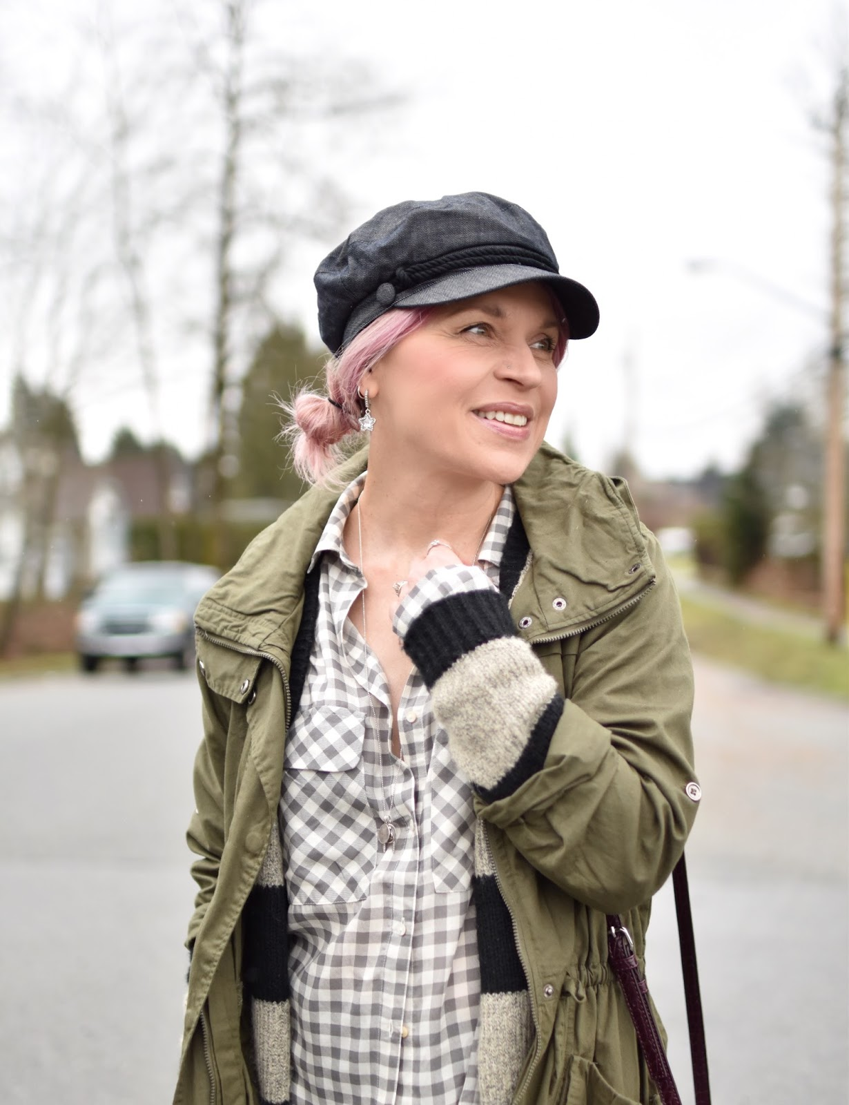 Monika Faulkner outfit inspiration - denim baker boy cap, gingham shirt, striped cardigan, army-style parka