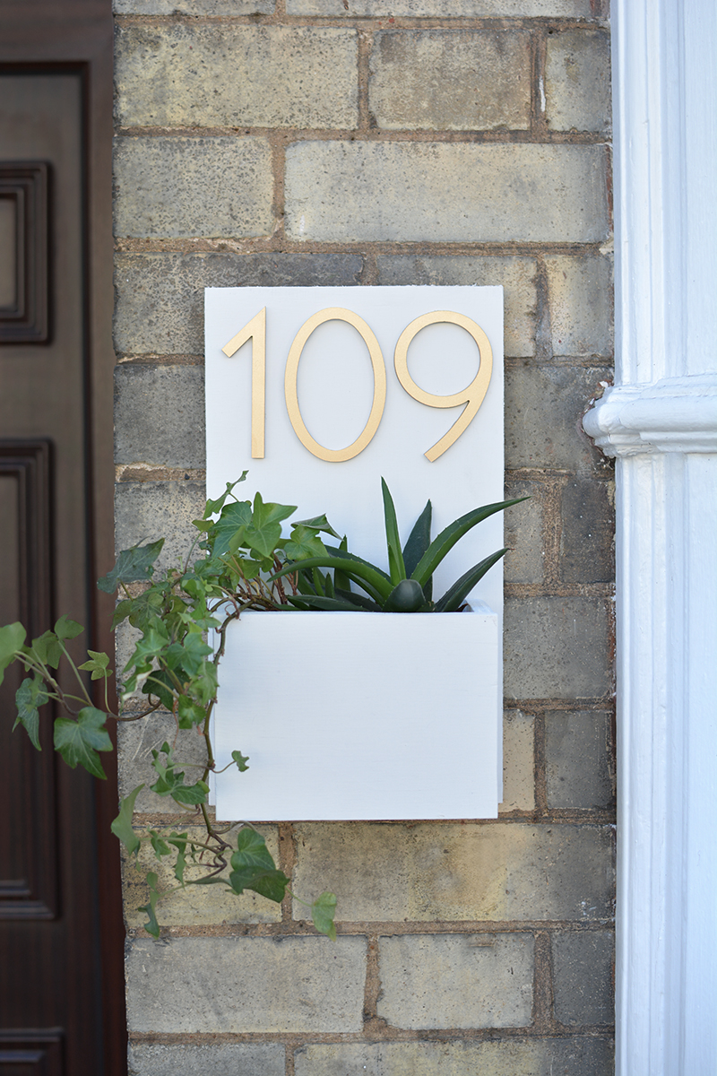 white mid century house number sign