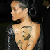 Turns out Rihanna tattooed Drake's face on her back, see photo