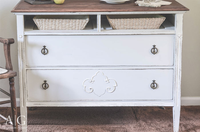 A broken antique dresser is given a makeover and repurposed as a dining room buffet.  |  www.andersonandgrant.com