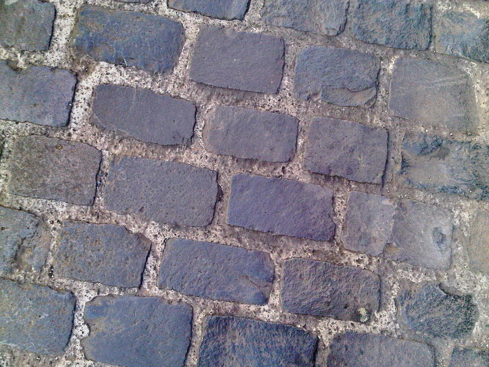 a city street with basalt stones