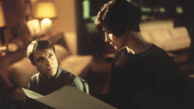 Juliette Binoche as Julie and Benoît Régent as Olivier in blue, discussing musical composition written by Julie's late husband, Directed by Krzysztof Kieslowski
