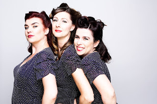 Vintage style photo of The Decibelles with polka dot dresses