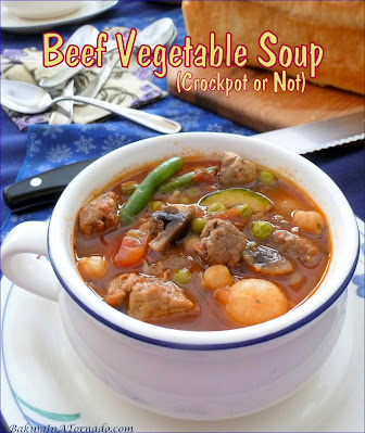 Beef Vegetable Soup is a hearty dinner made either in a slow cooker or on the stove top. Lean stew beef is slow cooked, add beans, vegetables, and rice for a one bowl full meal. | Recipe developed by www.BakingInATornado.com | #recipe #dinner