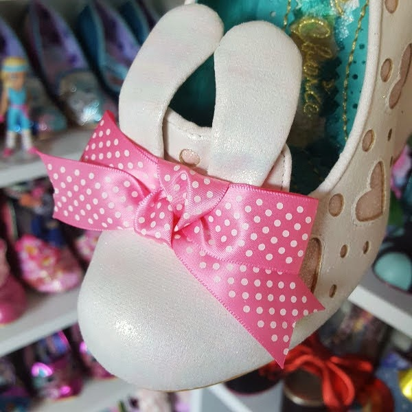 close up of tow of shoe with pink polka dot bow and bunny ears