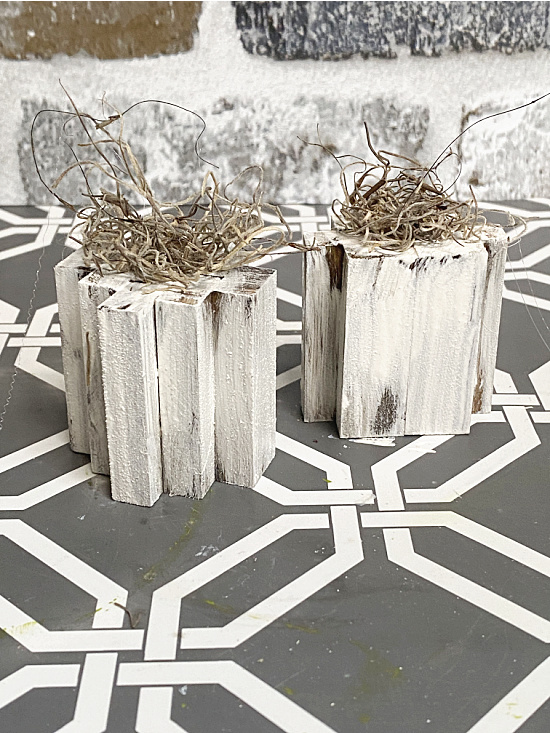 white distressed pumpkins with Spanish moss