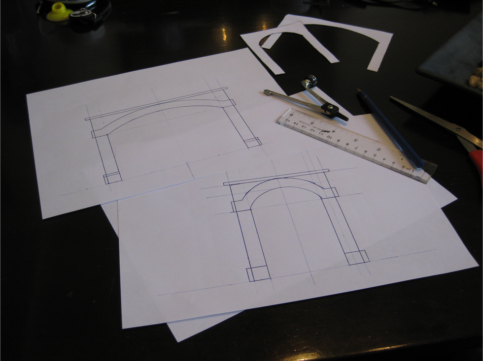 Tunnel portal templates and specifications drawn out on white copy paper