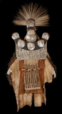Costume made up of a headdress, mask, apron and barkcloth cape