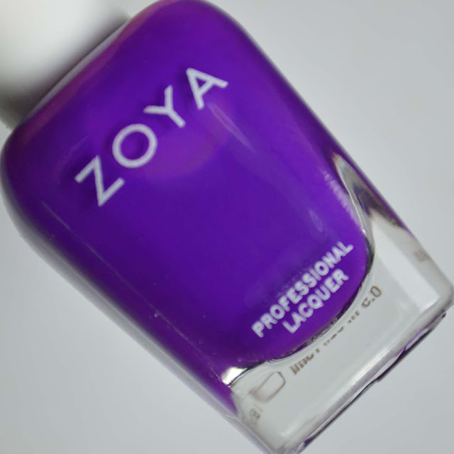 neon purple nail polish in a bottle