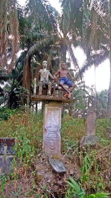 """""""The next generation will have no regard for the 'gods'"""" - Nigerian pastor says as he shares pictures of a boy sitting beside a deity in a shrine"""