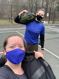 Two women outdoors in work out clothing.