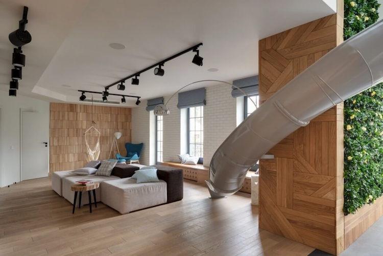 reforma de un apartamento con un tobogán en el salón